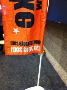 Reverse side of a Talkaoke banner.